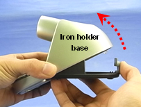 2. Open the iron holder base while pressing the slide lock.
